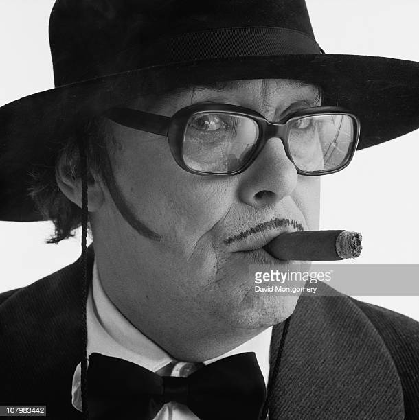 English comedian Eric Morecambe wearing a drawnon moustache 8th February 1982