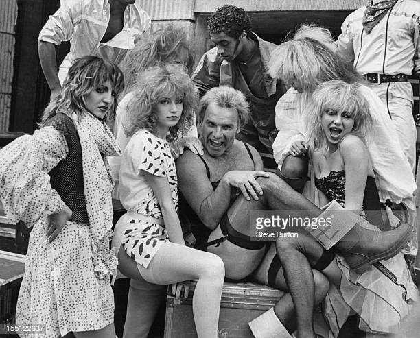 English comedian Freddie Starr poses in London with British dance troupe Hot Gossip 27th March 1981 Starr is embarking on a British theatre tour with...