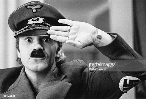English comedian Freddie Starr wearing an Adolf Hitler costume in his dressing room at the Winter Gardens theatre Margate East Kent August 1977
