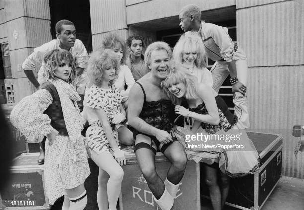 English comedian Freddie Starr with members of dance troupe Hot Gossip at a press event to launch his upcoming theatre tour London 27th March 1981