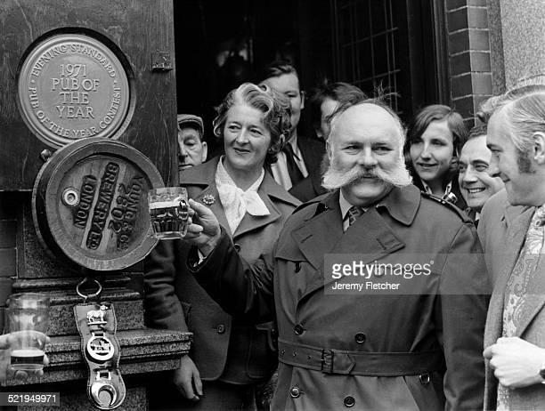 English comedian Jimmy Edwards presents the Evening Standard Pub of the Year award to the Duke of Cumberland in Parsons Green London 1971