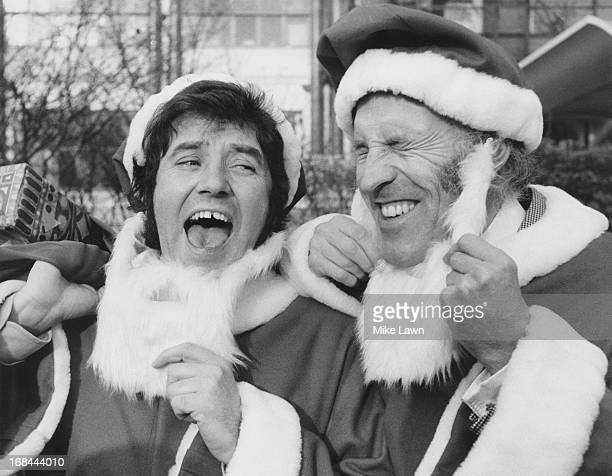 English comedian Jimmy Tarbuck and entertainer Bruce Forsyth in santa outfits at a reception to welcome the stars of ITV television's Christmas...