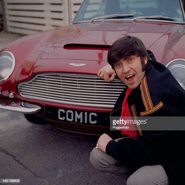 English comedian Jimmy Tarbuck posed with his red Aston Martin DB6 sporting the number plate 'Comic' in 1968