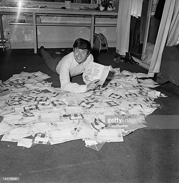 English comedian Jimmy Tarbuck reads good luck telegrams in his dressing room at the London Palladium 26th September 1965