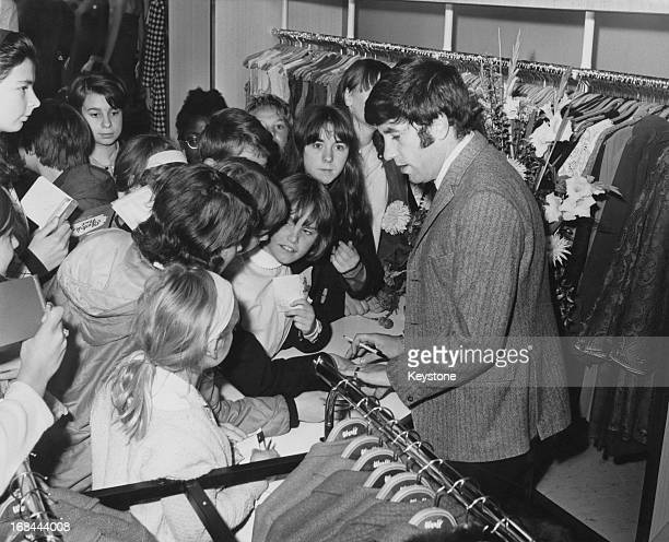 English comedian Jimmy Tarbuck surrounded by fans after he opened a Werff clothes shop in Hounslow London 1st October 1966
