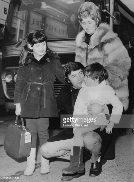 English comedian Jimmy Tarbuck with his wife Pauline and their daughters Cheryl and Lisa at London Airport before a holiday flight 22nd February 1969