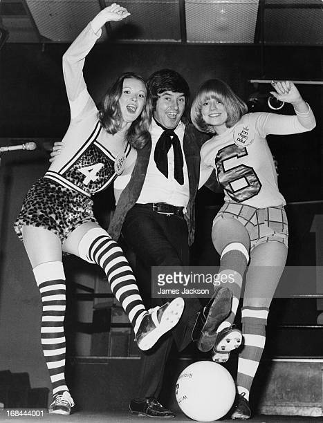 English comedian Jimmy Tarbuck with models Beate and Sally Ann Vancliffe before a charity football match at Hurlingham Park stadium in Fulham London...