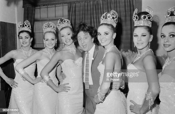 English comedian Ken Dodd backstage with the Bluebell Girls during a rehearsal for the show 'Doddy's Here Again' at the London Palladium UK 2nd June...