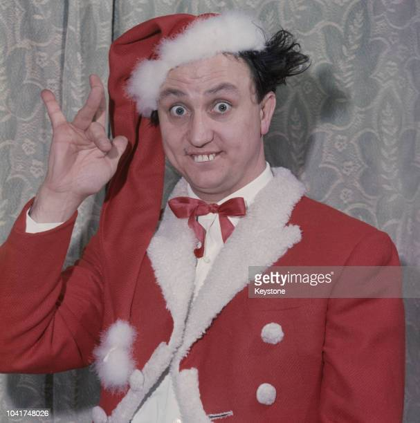 English comedian Ken Dodd wearing a Santa Claus outfit at the Royal Court Theatre in Liverpool, UK, circa 1972.