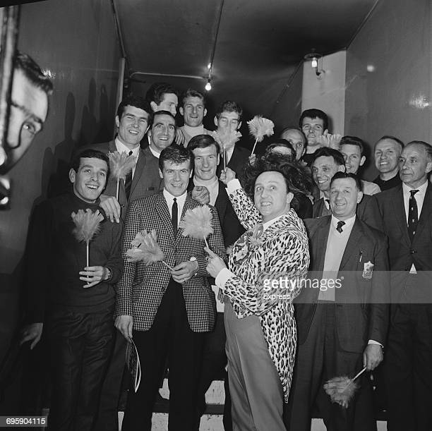 English comedian Ken Dodd with members of Liverpool FC and feather dusters UK 30th April 1965