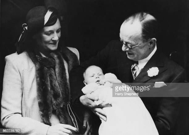 English comedian Leslie Henson and his wife actress Harriet 'Billie' Dell at the christening of their baby son Nicholas Victor Leslie Henson who...