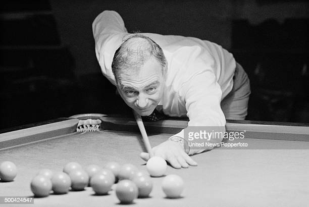 English comedian Roy Hudd plays a game of snooker on 13th July 1984