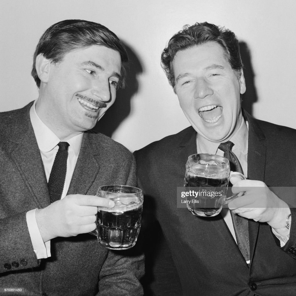 English comedian, singer, actor and variety performer Max Bygraves (1922 - 2012) and English jazz musician Kenny Ball (1930 - 2013) celebrating their first collaboration and single 'Rosie/Harmonize', London, UK, 11th January 1967.