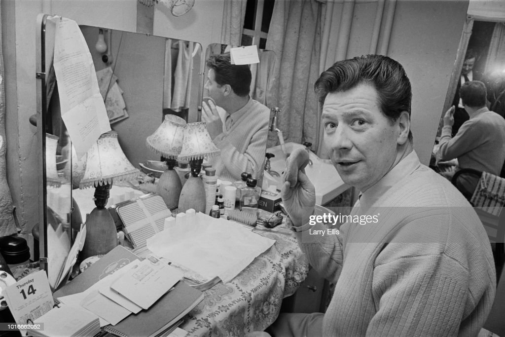English comedian, singer, actor and variety performer Max Bygraves (1922 - 2012) getting ready in a dressing room, UK, 15th January 1965.