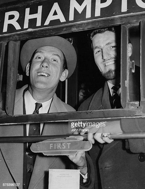 English comedian Tommy Trinder Director of Fulham Football Club and Fulham football player Jimmy Hill smiling out of their train carriage window as...