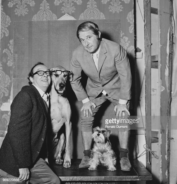 English comedians Eric Morecambe on left and Ernie Wise of the comedy duo Morecambe and Wise pictured with Great Dane and Schnauzer dogs 'Lady' and...