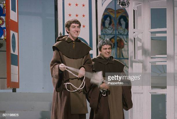 English comedians Peter Cook and Dudley Moore pictured dressed as monks in a sketch from the television series 'Not OnlyBut Also' in 1966