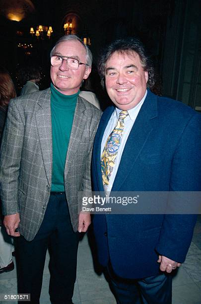English comedians Syd Little and Eddie Large attending the first night opening of Jim Davison's adult pantomime 'Sinderella', 9th March 1994.