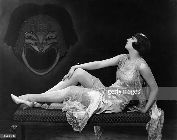 English comedy actress Jessie Matthews poses on a chaise longue in a scene from the revue 'Wake Up And Dream' at the London Pavilion