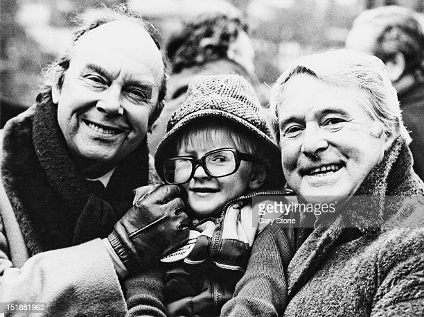 English comedy double act Eric Morecambe and Ernie Wise with 4 yearold leukemia sufferer Mark King at the Children of Courage awards Westminster...