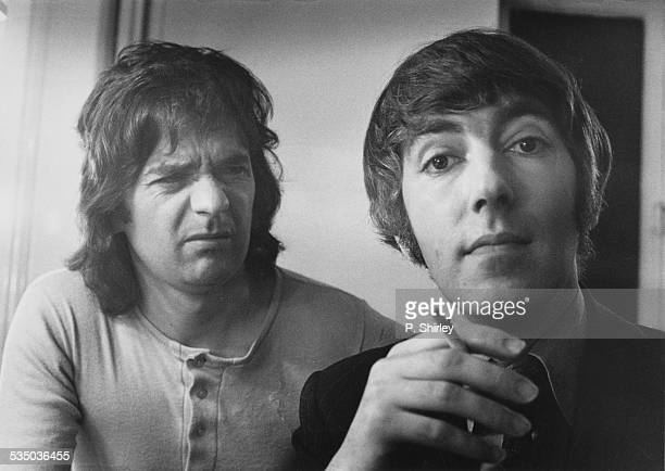 English comedy duo Dudley Moore and Peter Cook 21st May 1973 Moore appears unimpressed by Cooke's cigarette which is made with synthetic tobacco