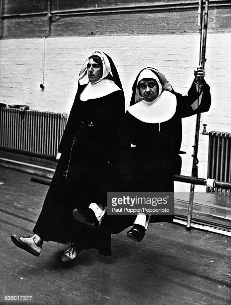 English comedy duo Peter Cook and Dudley Moore dressed as nuns for a fundraising concert in aid of the British satirical magazine 'Private Eye' 2nd...