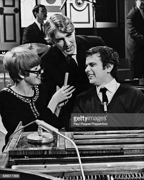 English comedy duo Peter Cook and Dudley Moore with guest star English singer Cilla Black at a rehearsal for Cook and Moore's Popperfoto via Getty...