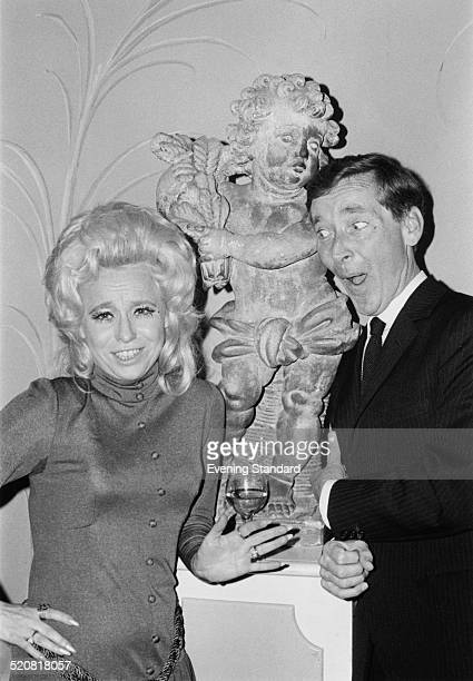 English comic actor and comedian Kenneth Williams and English actress Barbara Windsor at a party being held to celebrate the 21st 'Carry On' film...