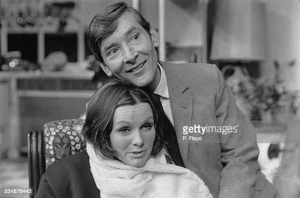 English comic actor and comedian Kenneth Williams and English actress Jennie Linden in a production of Charles Laurence's stage comedy 'My Fat...