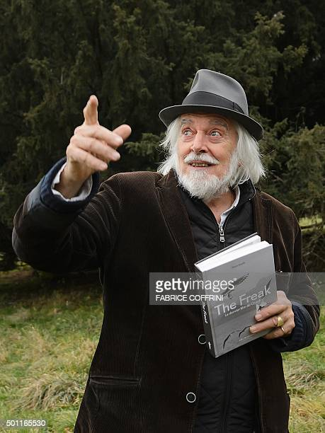 English comic actor and filmmaker Charlie Chaplin's 69yearold son Michael gestures with a book entitled 'The Freak the last film of Chaplin' on...