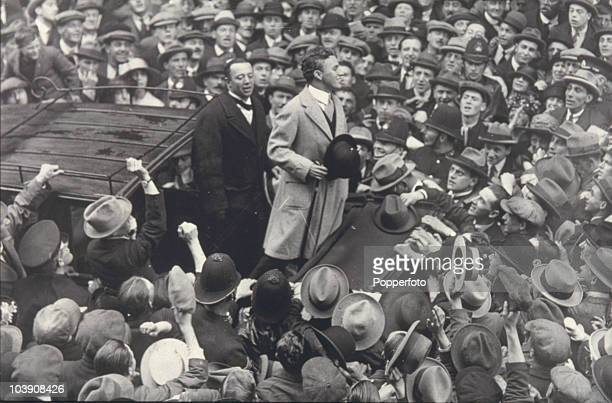 English comic actor Charlie Chaplin addresses a crowd outside the Ritz Hotel where he is staying London 10th September 1921