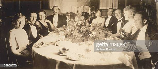 English comic actor Charlie Chaplin and American actor Douglas Fairbanks Sr at a Hollywood party, 1919.