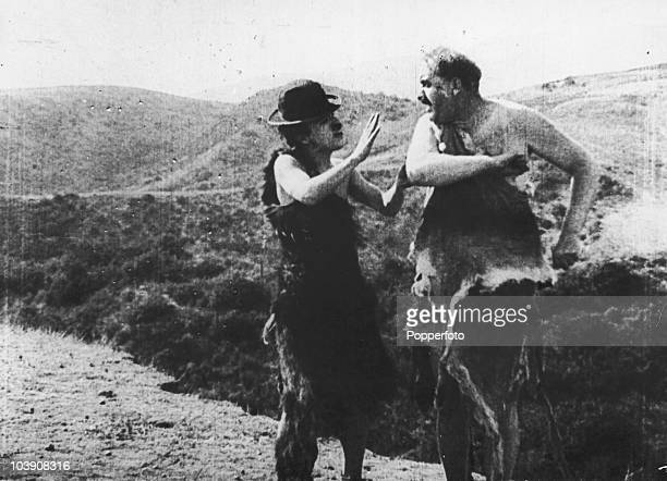 English comic actor Charlie Chaplin and Mack Swain in a scene from the 'His Prehistoric Past' a silent tworeeler written and directed by Chaplin and...