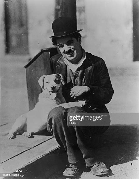 English comic actor Charlie Chaplin with Mutt the dog who played Scraps in the silent comedy 'A Dog's Life' Chaplin's first film for First National...