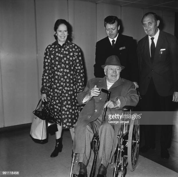 English comic actor, filmmaker, and composer Charlie Chaplin and his wife, Oona O'Neill , arrive at Heathrow Airport, London, UK, 22nd May 1973.