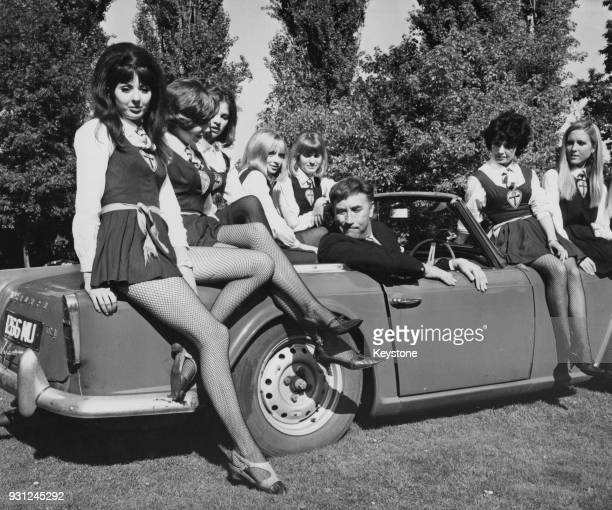 English comic actor Frankie Howerd with some of the actresses from the film 'The Great St Trinian's Train Robbery' at Shepperton Studios UK 4th...