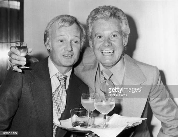 English comic actor John Inman with Irish female impersonator Danny La Rue at a Variety Club dinner celebrating La Rue's 25 years in show business at...