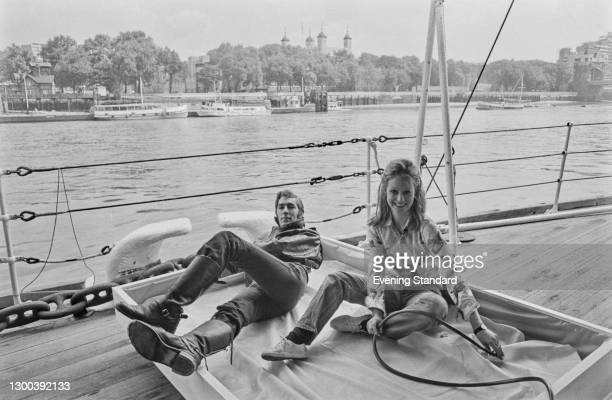 English comic actor Peter Cook on a yacht on the River Thames in London with Lady Jacqueline Rufus Isaacs, daughter of the 3rd Marquess of Reading,...