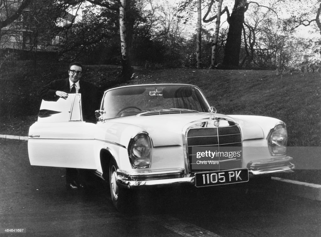 English comic actor Peter Sellers (1925 - 1980) with his new Mercedes-Benz 300 SE Cabriolet (aka Mercedes-Benz W112), 7th November 1962. Sellers bought the car for eight thousand pounds, saving seven hundred after a goverment cut in Purchase Tax.
