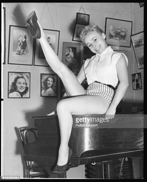 English comic actresss Barbara Windsor practising high kicks for her role in 'Red Riding Hood' at the Aida Foster Stage School London 1955