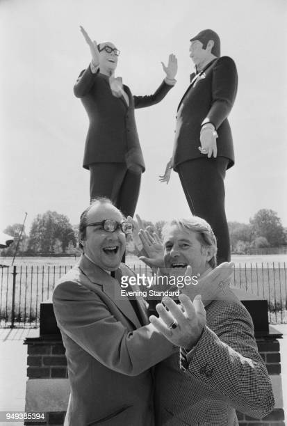 English comic double act 'Morecambe and Wise' Eric Morecambe and Ernie Wise posing in front of sculpture of themselves in Regent's Park London UK 2nd...