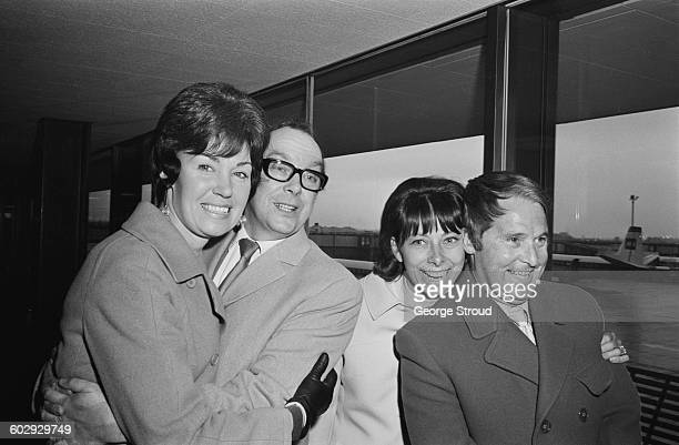 English comic duo Eric Morecambe and Ernie Wise leave London Airport with their wives Joan and Doreen bound for the Montreux Festival in Switzerland...