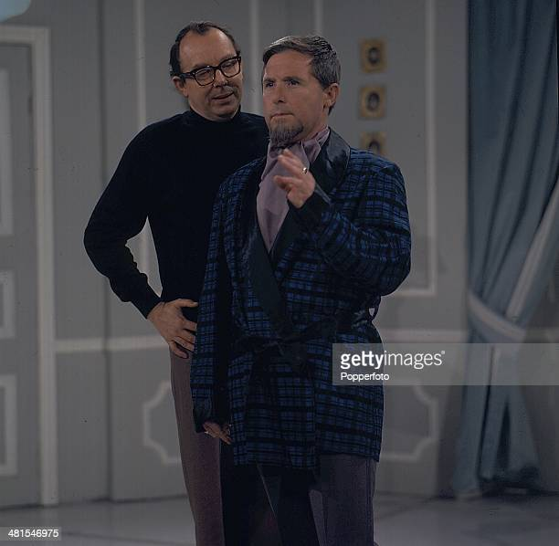 1968 English comic duo Eric Morecambe and Ernie Wise of Morecambe and Wise perform together on their television series 'The Morecambe and Wise Show'...