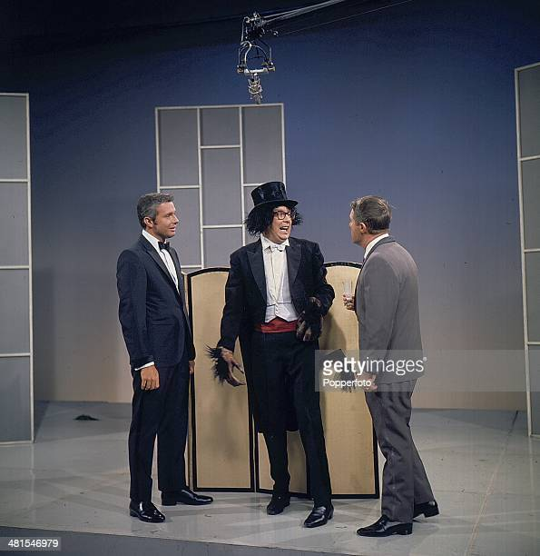 1968 English comic duo Eric Morecambe and Ernie Wise of Morecambe and Wise perform together with Canadian singer Edmund Hockridge on their television...