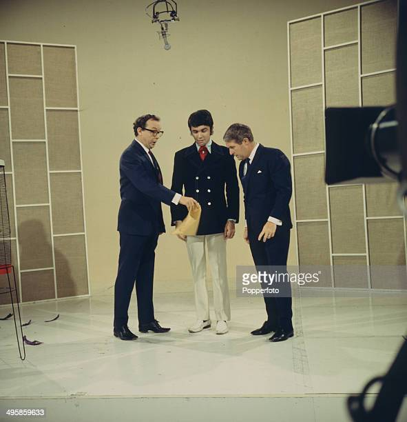 English comic duo Eric Morecambe and Ernie Wise of Morecambe and Wise pose with Dave Clark from the Dave Clark Five on their television series 'The...
