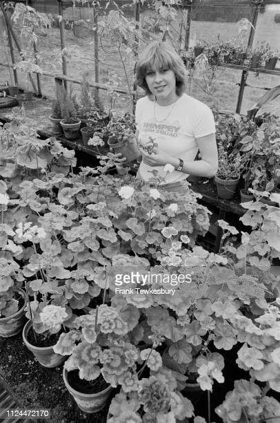 English competitive swimmer Sharron Davies in a greenhouse, Uk, 23rd April 1980.