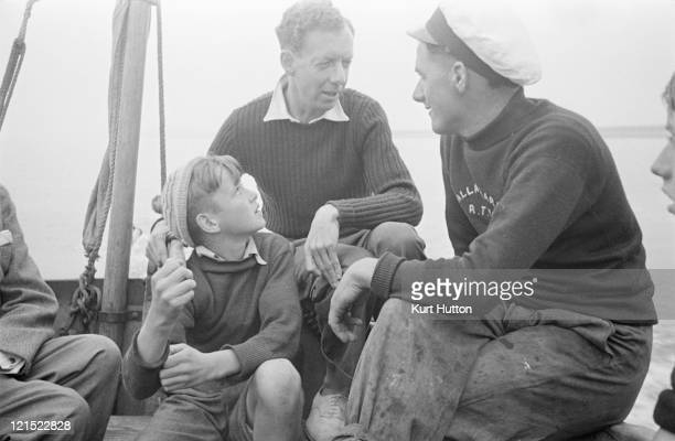English composer and conductor Benjamin Britten on a boat in Aldeburgh Suffolk with friends October 1949 Original Publication Picture Post 4896 An...