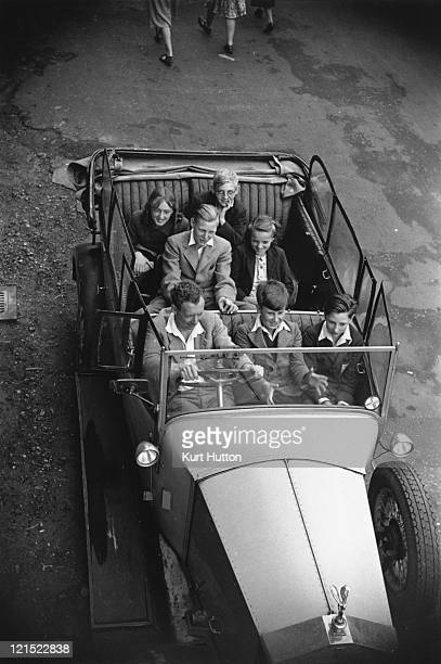 English composer and conductor Benjamin Britten with a car full of youngsters in Aldeburgh Suffolk October 1949 Original Publication Picture Post...