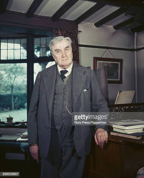 English composer and conductor, Ralph Vaughan Williams pictured standing beside a piano at home in Surrey, England in January 1949.