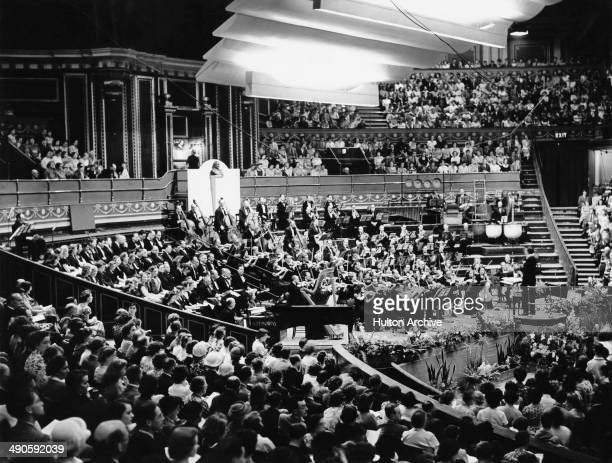 English composer and conductor Stanford Robinson leads the BBC Opera Orchestra at the Royal Albert Hall in London circa 1950